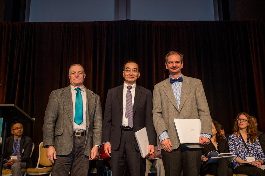 László Erdős (right), Horng-Tzer Yau of Harvard University (center), and AMS President Robert Bryant (left) (© Kate Awtrey, Atlanta Convention Photography)