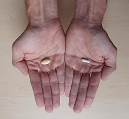 Illustration of hands with pills